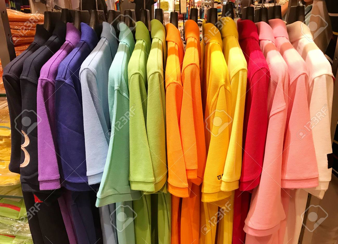 3896708cf15 Rainbow or multi color polo shirts on hanger are hanging for sale in store  Stock Photo