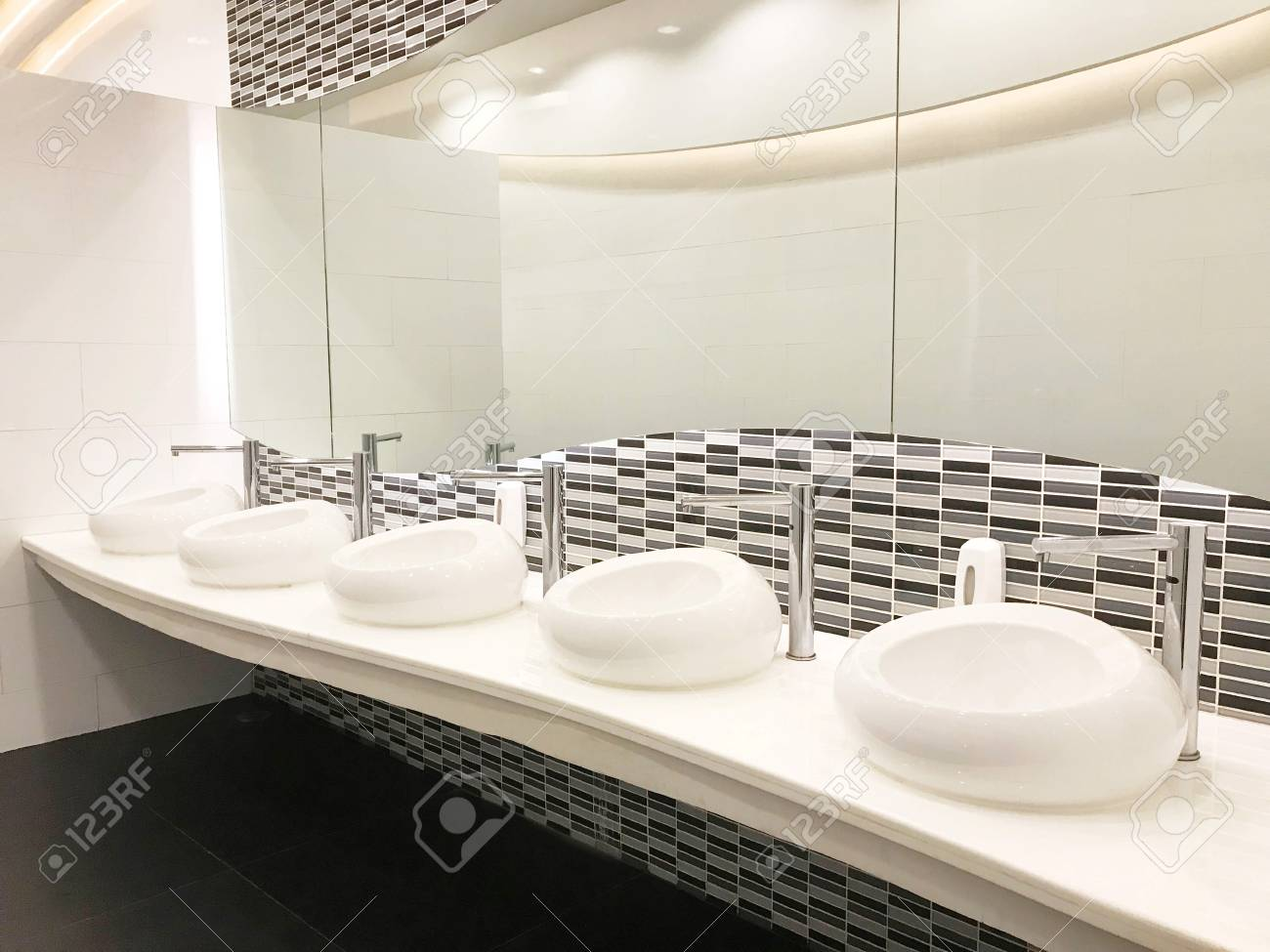 Row Of Modern White Ceramic Wash Basin In Public Toilet Or ...