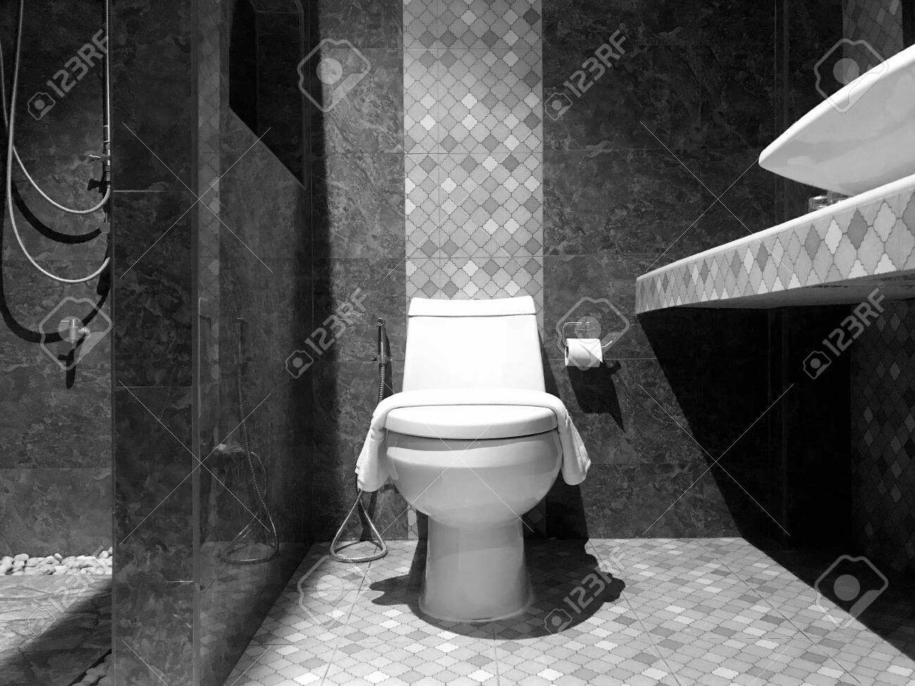 White Modern Flush Toilet Bowl Against Marble Wall Bathroom Stock Photo Picture And Royalty Free Image Image 140168731