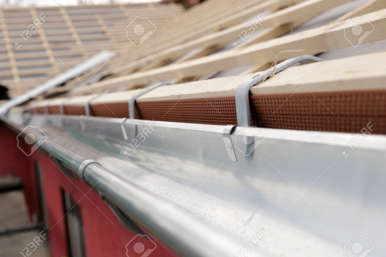 Connector plastic drip gutters on the roof, close up - 71388241
