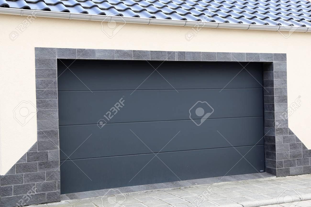 Modern new garage door (sectional door) - 107551935