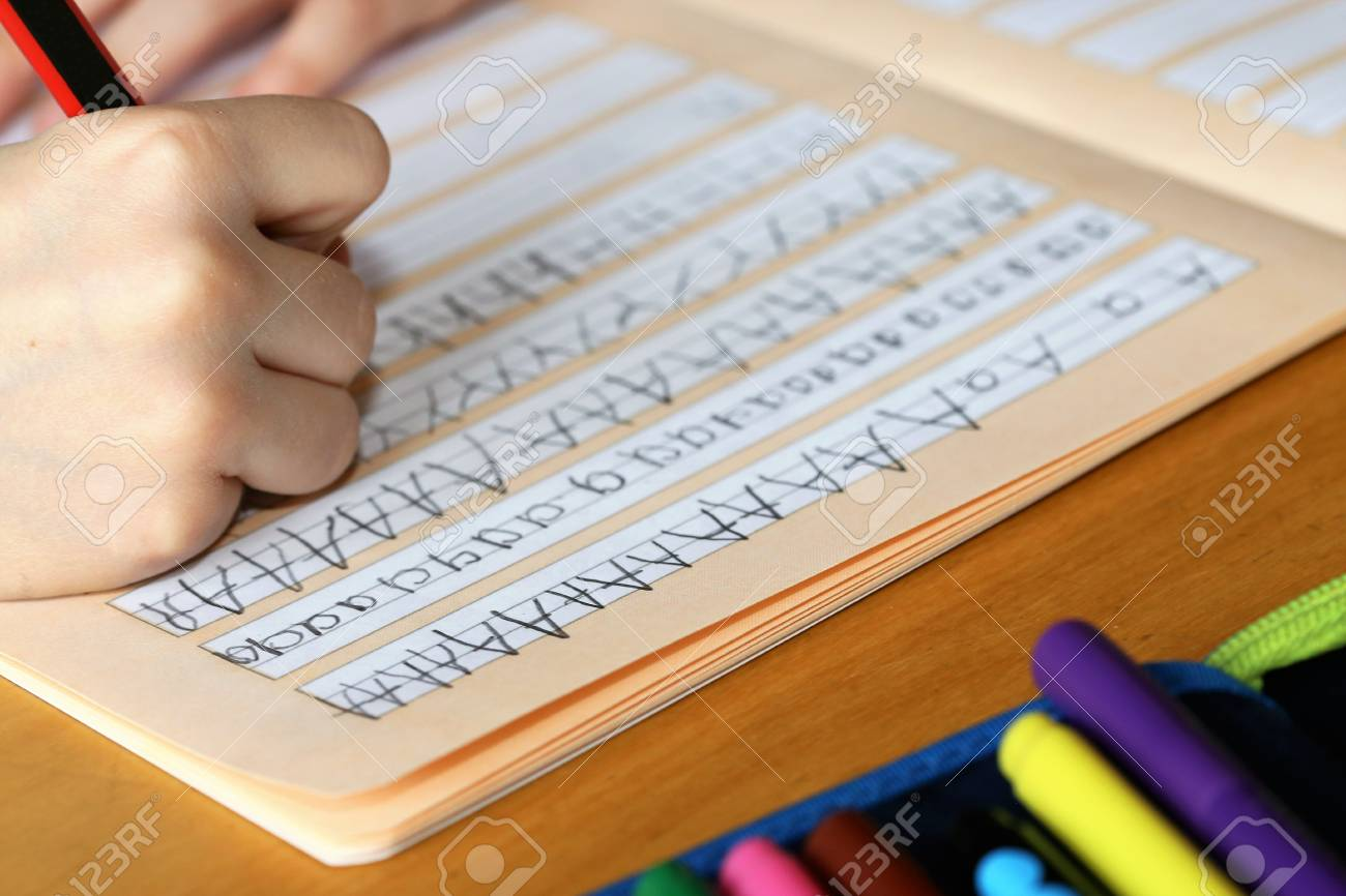 First grader learns writing - 119235191