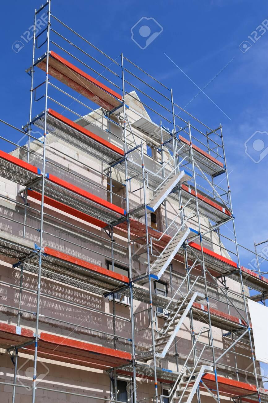 Scaffold on a building facade - 128297984
