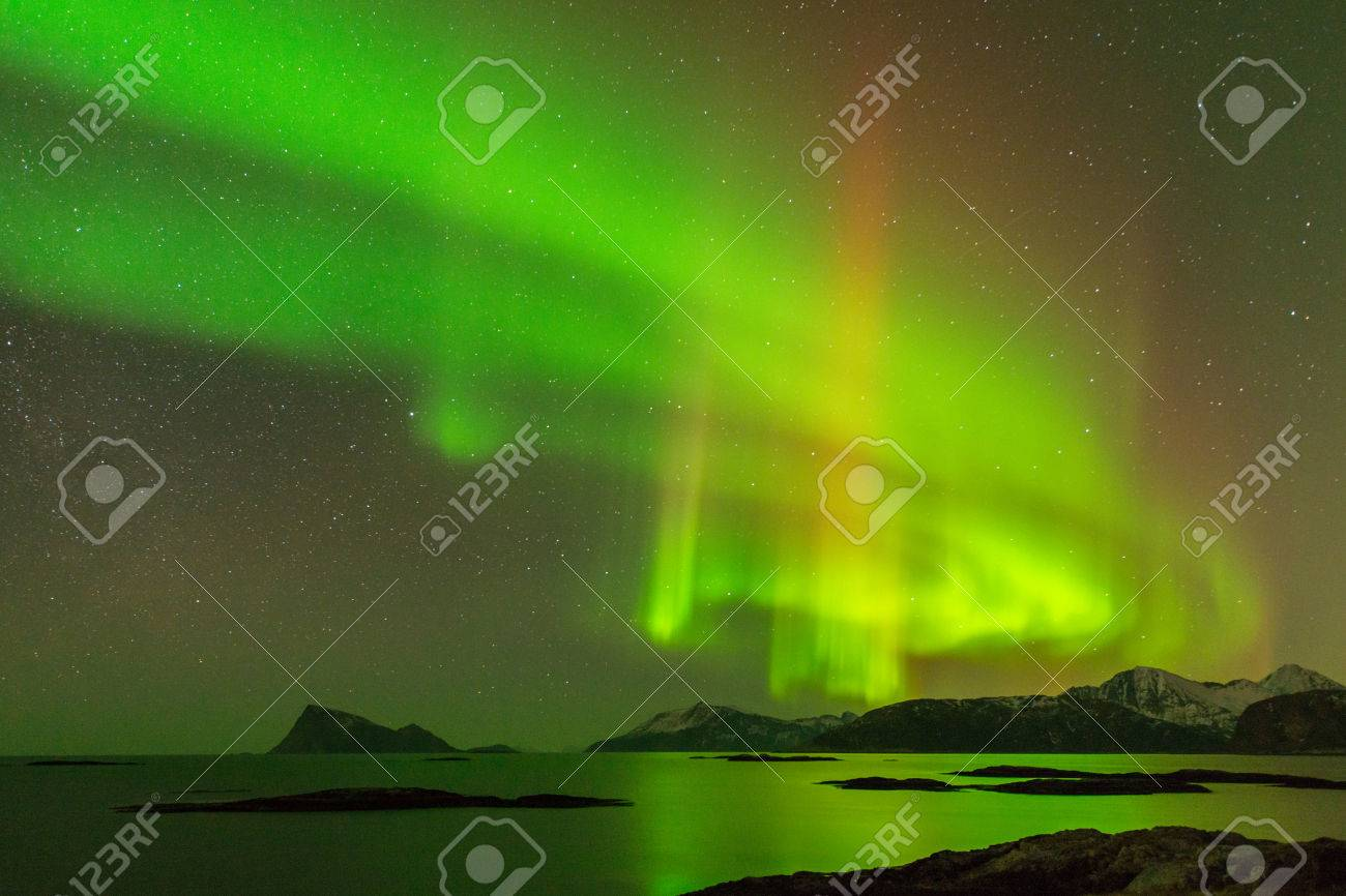 The Aurora Borealis  northern lights  photographed in Sommaroy, Norway Standard-Bild - 28463485
