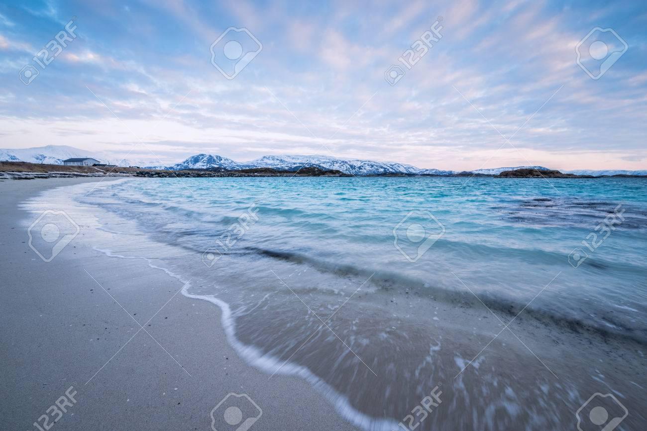Waves crashing on the beach in Sommaroy, Norway Standard-Bild - 28463515