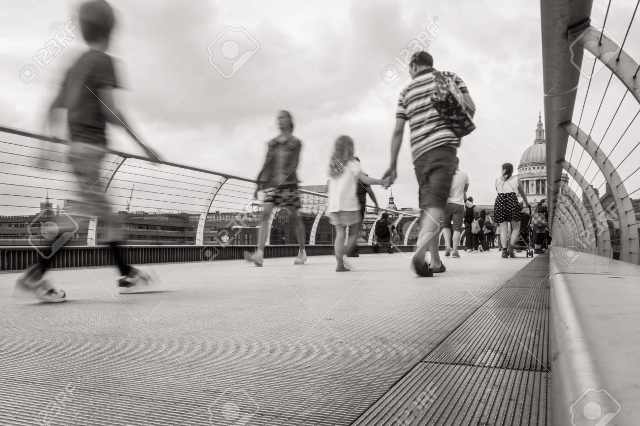 People walking over Millennium bridge Standard-Bild - 28649626