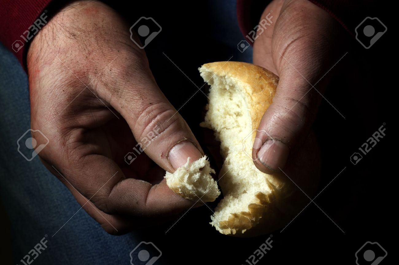 poverty, hands with bread Stock Photo - 13909860