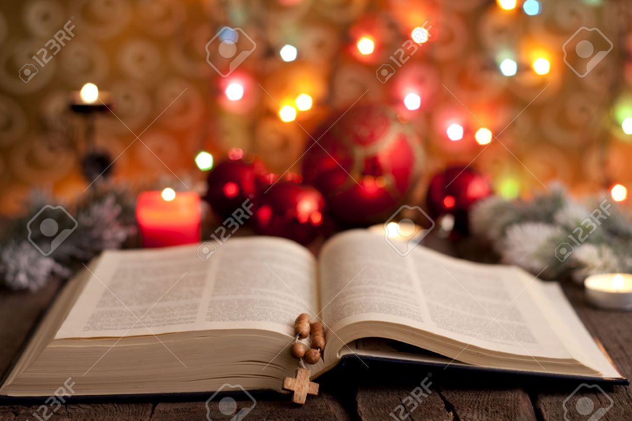 Christmas and bible with blurred candles light background Stock Photo - 15994954