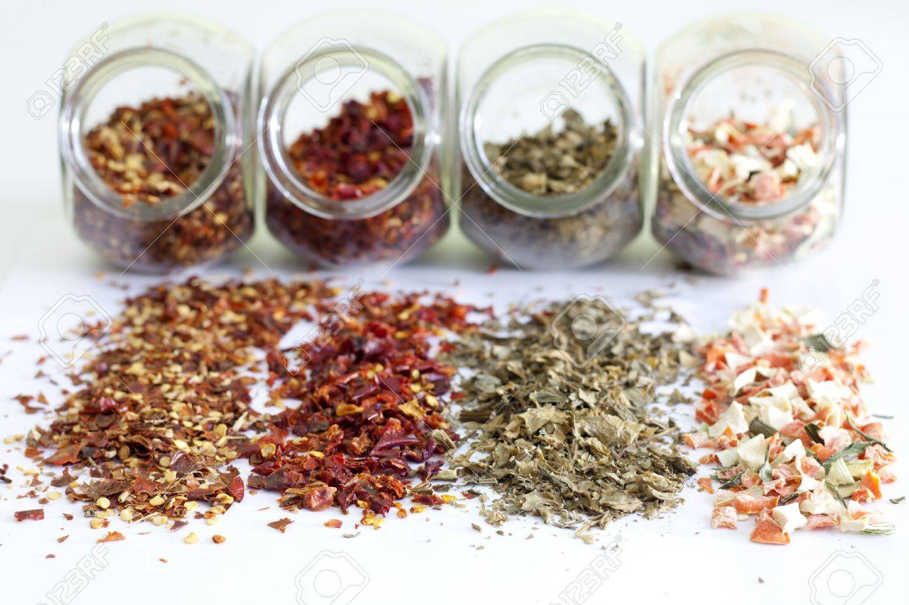 Dried spices in jar on white background closeup Stock Photo - 16910190