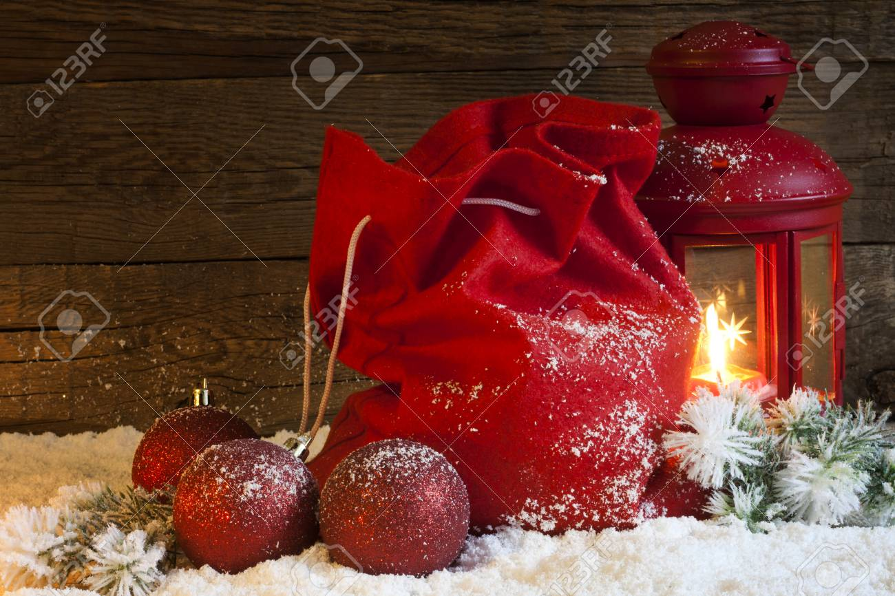 Christmas Lantern Gifts And Baubles On Snow Abstract Background ...