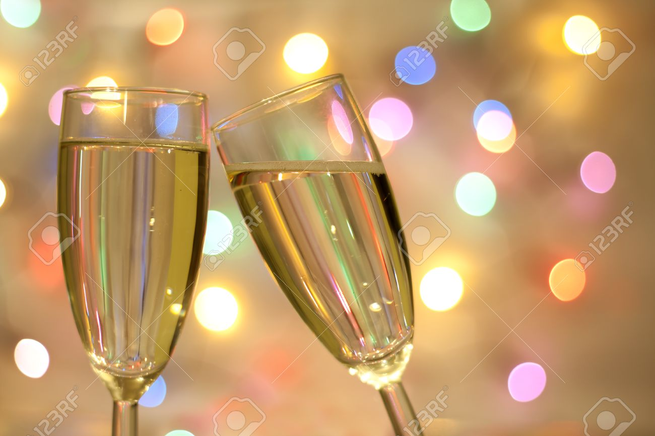 stock photo two glasses of champagne on blurred new year party wallpaper