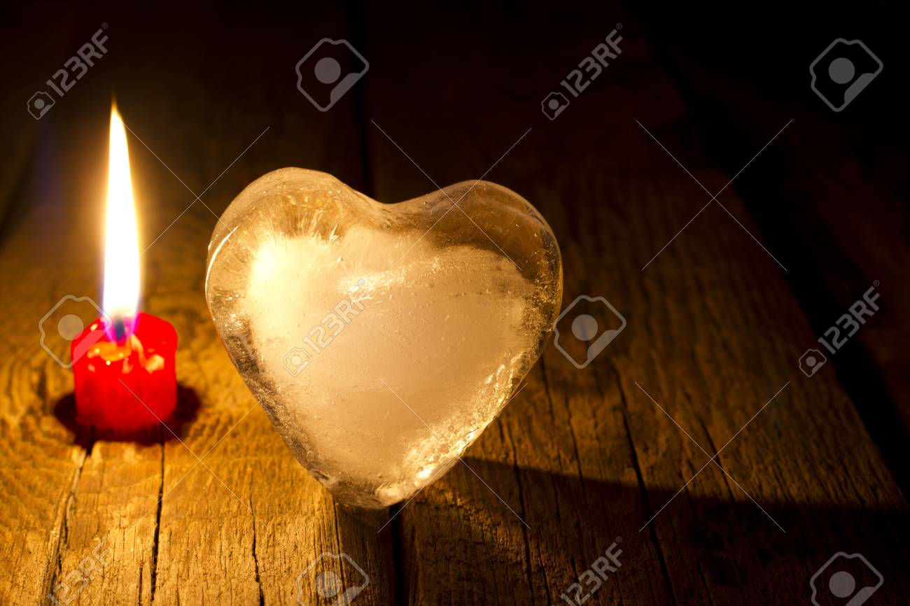 Ice heart and candle abstract Valentine s Day concept in night Stock Photo - 24756380