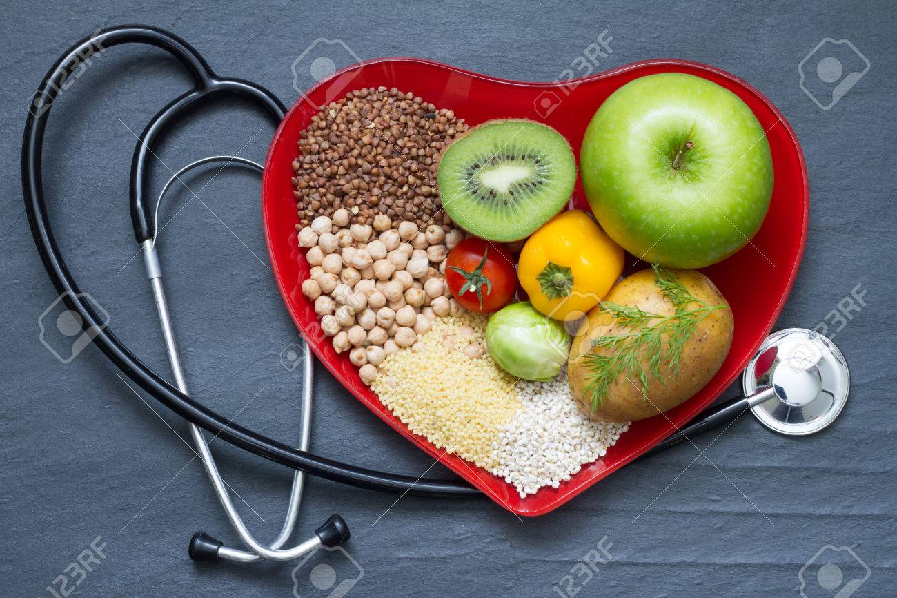Healthy food on red heart plate cholesterol diet concept - 51107611