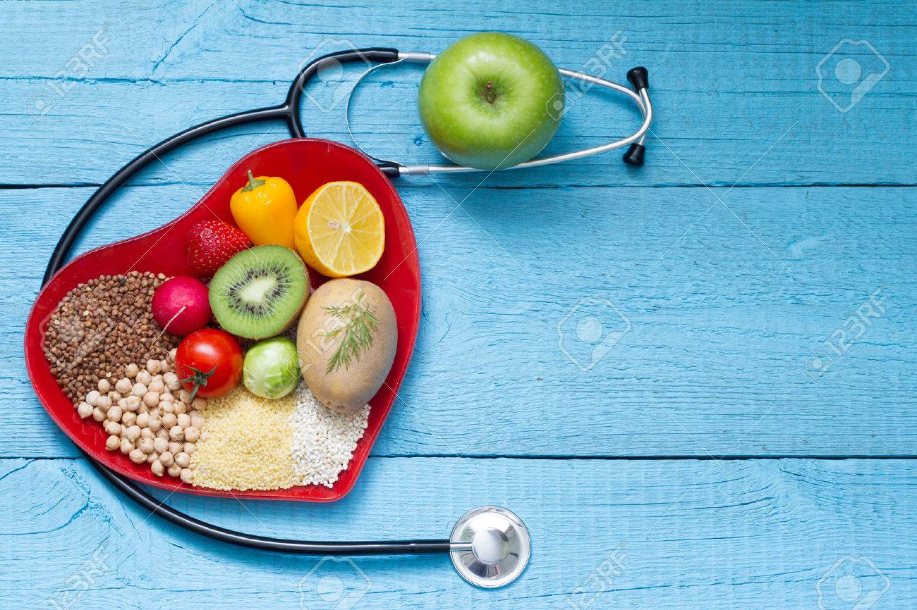 Food on heart plate with stethoscope cardiology concept - 51114375