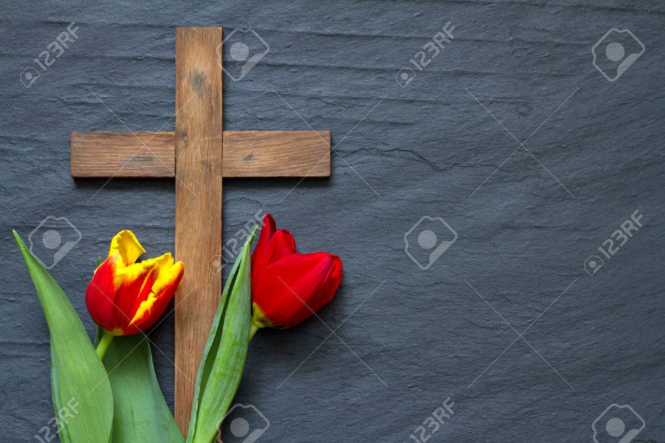 Abstract easter tulips and wooden cross on black marble - 51758214
