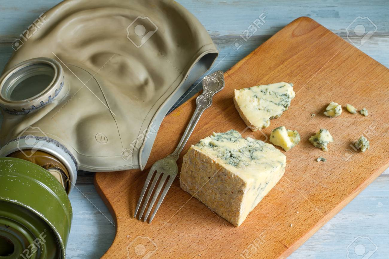 stinky cheese and gas mask funny abstract of food stock photo