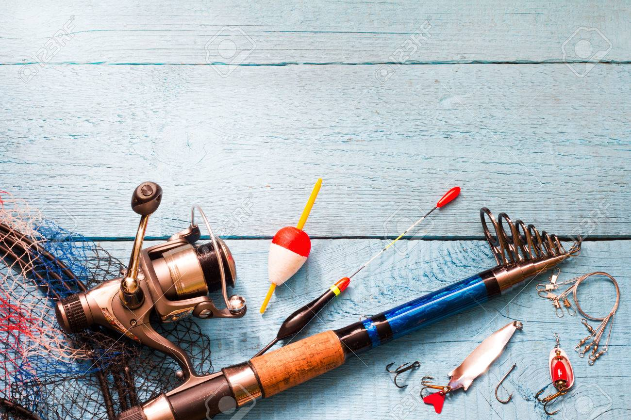 Fishing tackle on wooden blue background - 57144601
