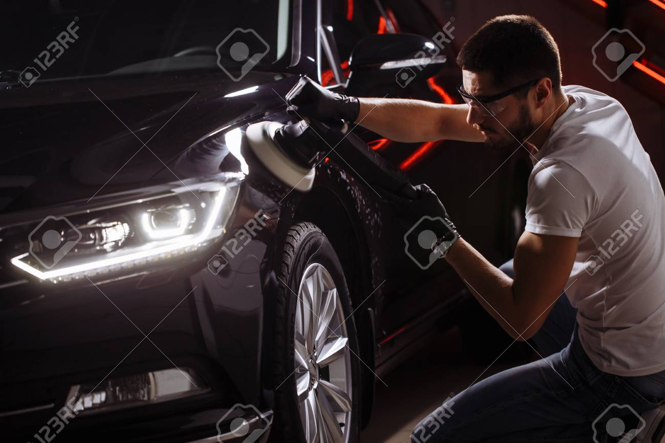 Car detailing - man with orbital polisher in auto repair shop. Selective focus. - 91823855