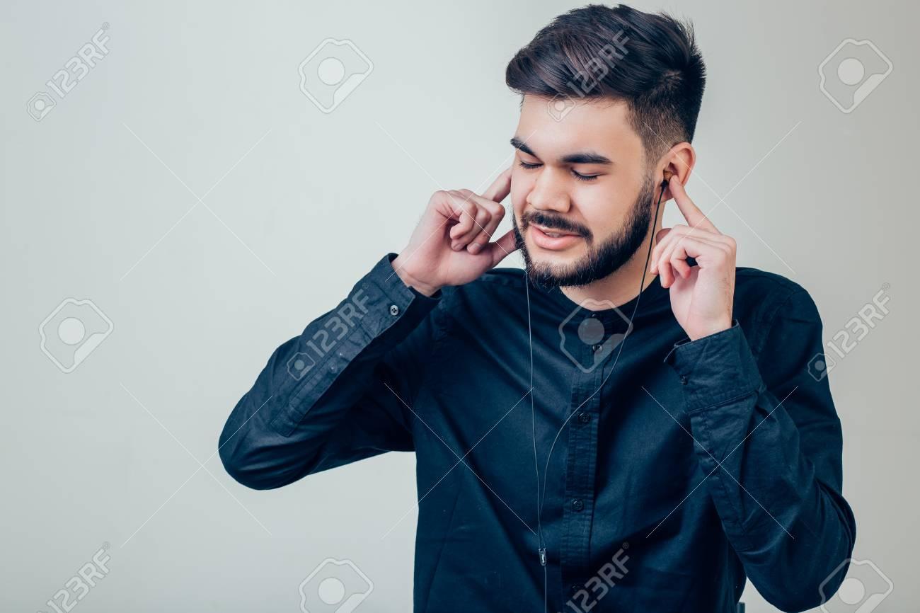 eacc0e02367 Bearded Man Blank Snapback Cap Summer Time.Young Men Using Smartphone  Headphones Stock Photo -