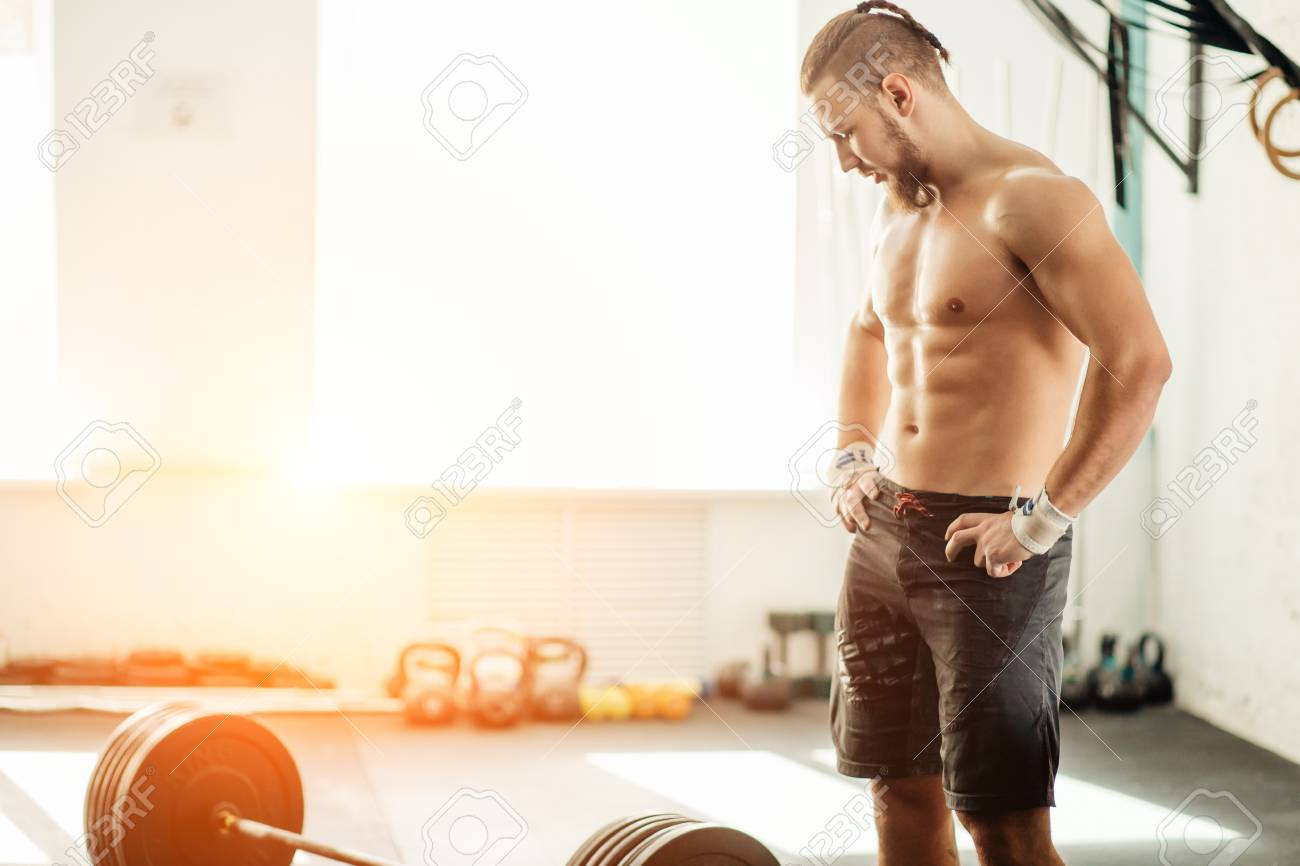 Pretty Man Tired After Weightlifting At Gym Stock Photo, Picture And  Royalty Free Image. Image 91703771.