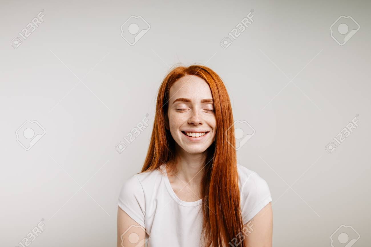 Beautiful ginger girl smiling posing with closed eyes - 92042022