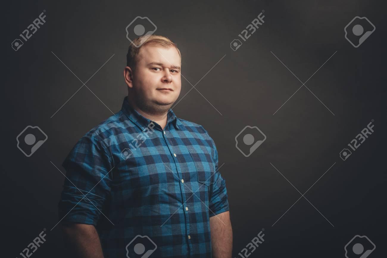 caucasian fat man looking at camera - 100363672