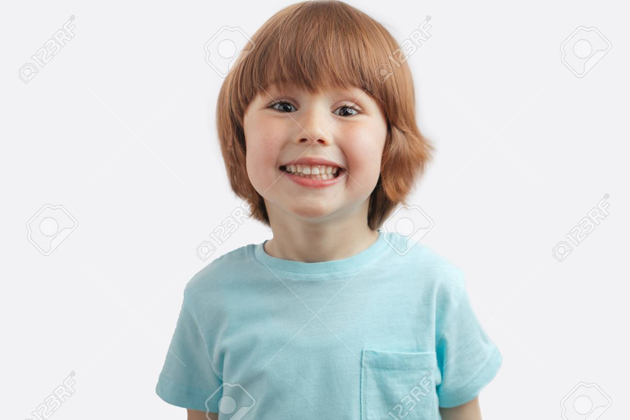 pretty red-haired kid showing his white teeth - 106654166