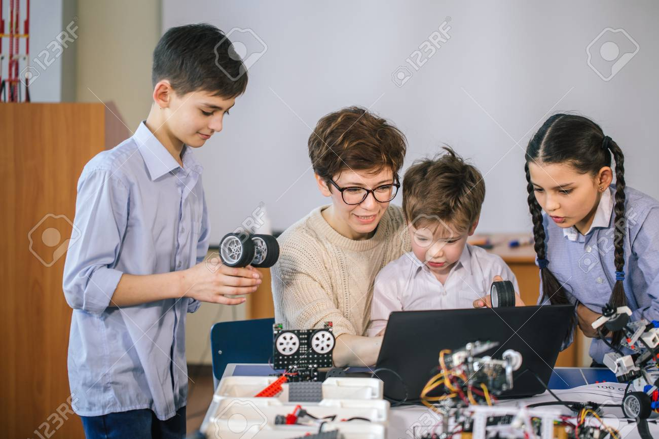Happy children learn programming using laptops on extracurricular classes - 108877780