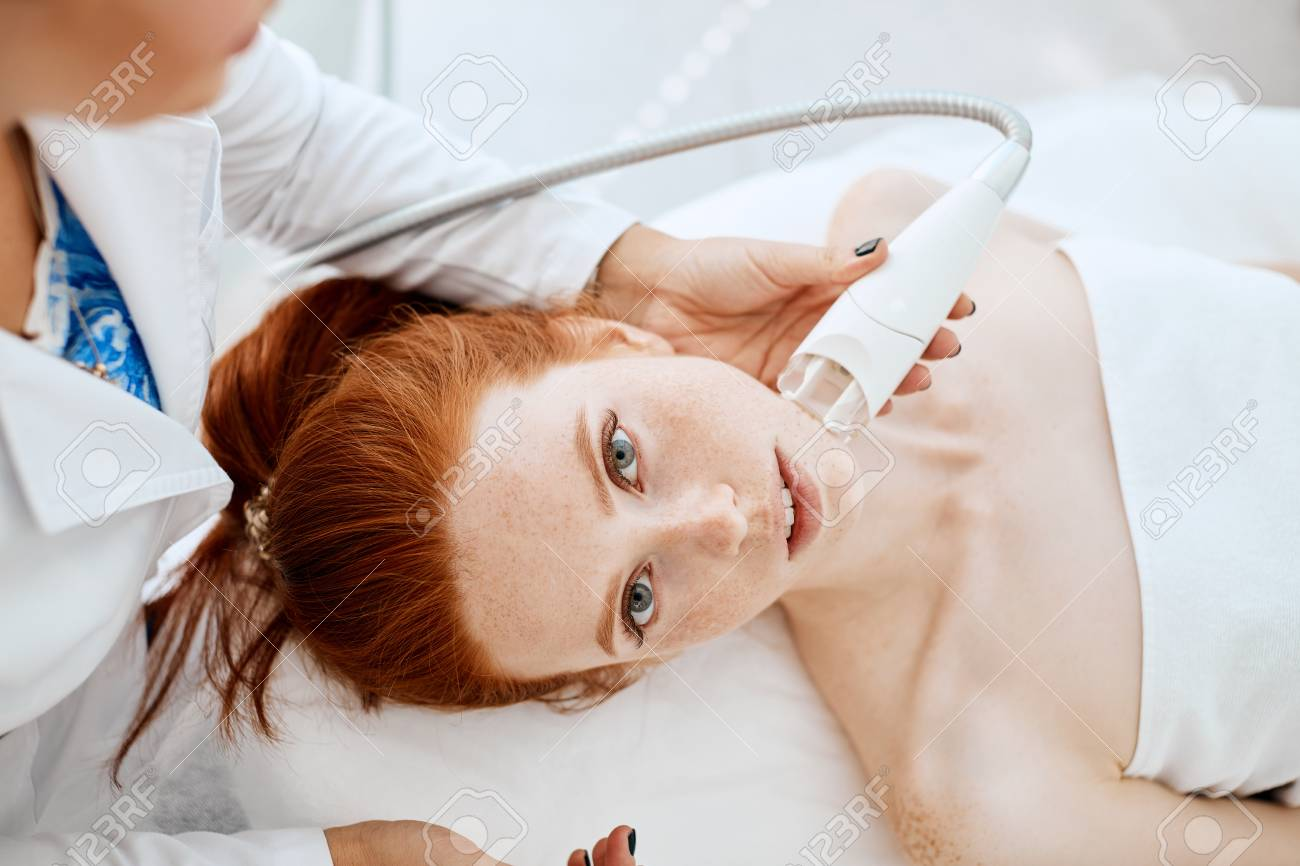 Woman getting rf-lifting in a beauty salon. Modern technologies in cosmetology. - 110564959