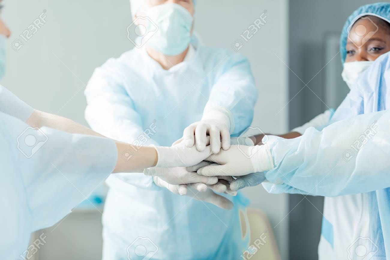 focus on doctors hands. team and unity concept.close up cropped photo. - 124806932
