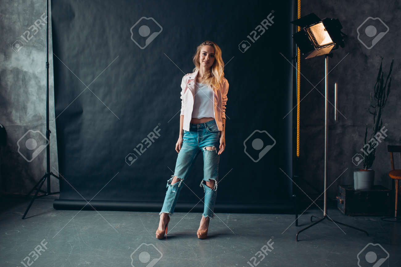Beautiful attracive model with long fair hair posing in photo studio.full length photo, beauty concept - 152456777