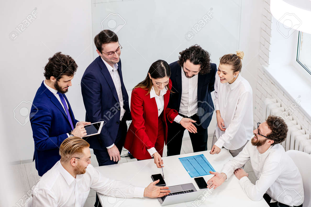 active discussion, co-working of young business partners or colleagues in modern office, wearing formal wear, enjoy working together, brainstorm time - 154586319