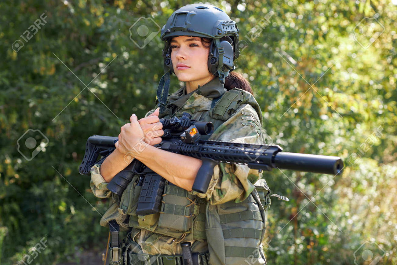 brave caucasian woman is engaged in hunting weapon gun or rifle, wearing military suit. target shot. female hunter in wild forest, nature. successful hunt. hunting sport concept - 159093148