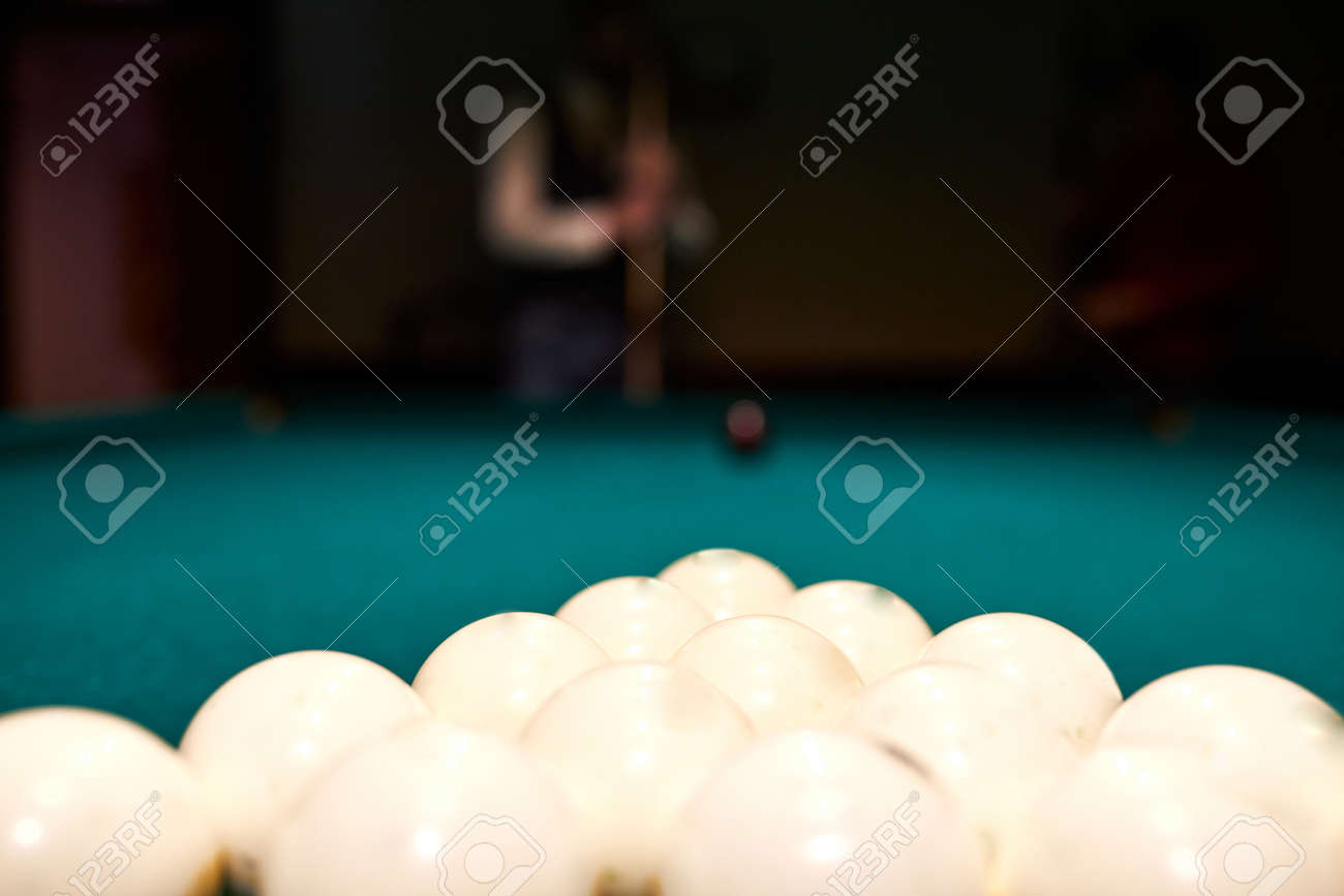 sports game of billiards on a blue cloth. white billiard balls close-up. cue ball on a pool table - 169212529
