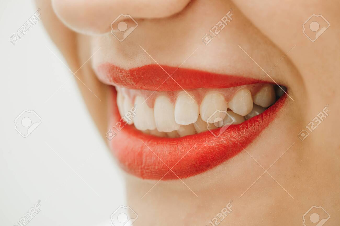 Beautiful toothy smile. Close up portrait of beautiful young happy smiling woman, isolated over white background. Laughing woman smile with great teeth. - 151468217
