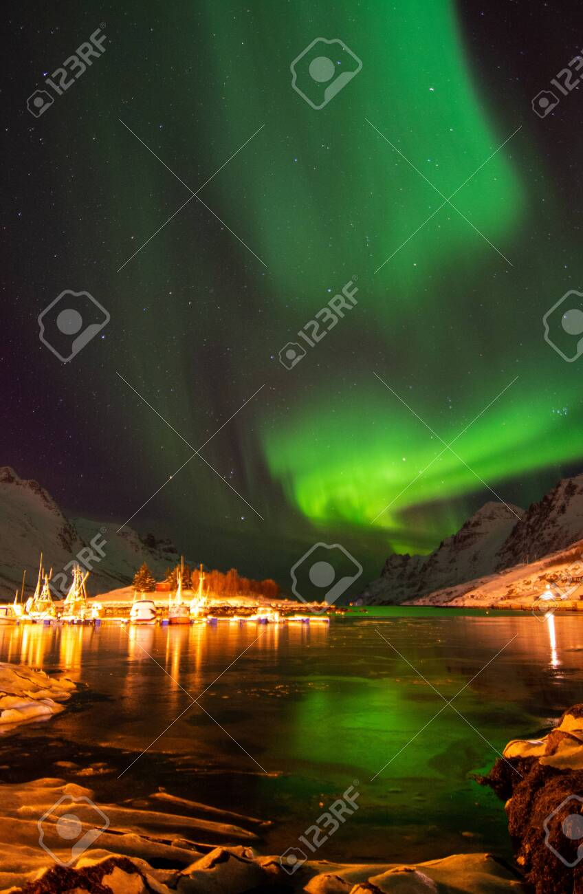 An aurora borealis, sometimes referred to as polar lights or northern lights, is a natural light display in the Earth's sky, predominantly seen in the high-latitude regions. - 142323116