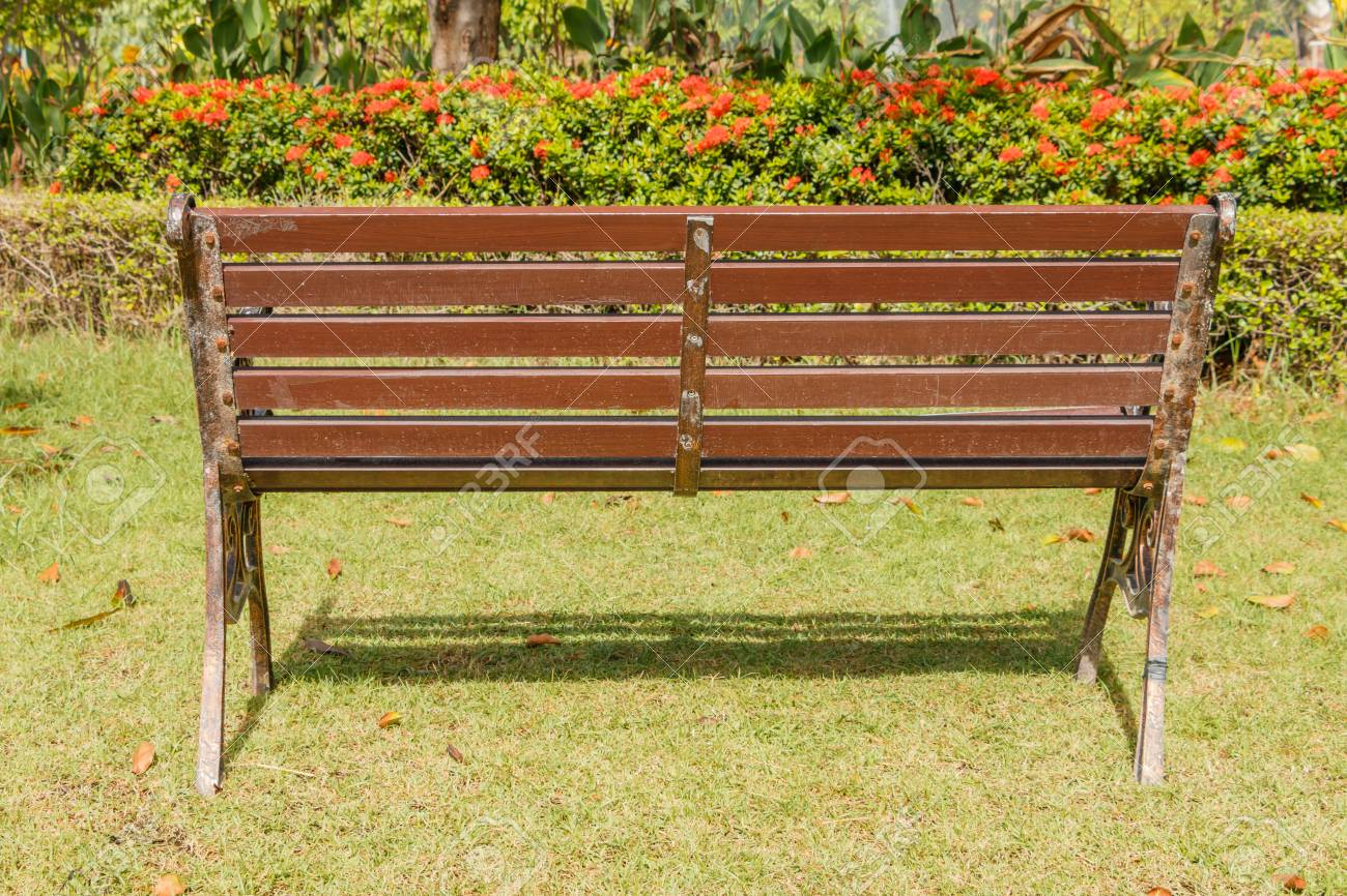 Red Oak Kitchen Table, Wooden Park Bench With Sunlight Bench Chair In The Garden On Stock Photo Picture And Royalty Free Image Image 46113410