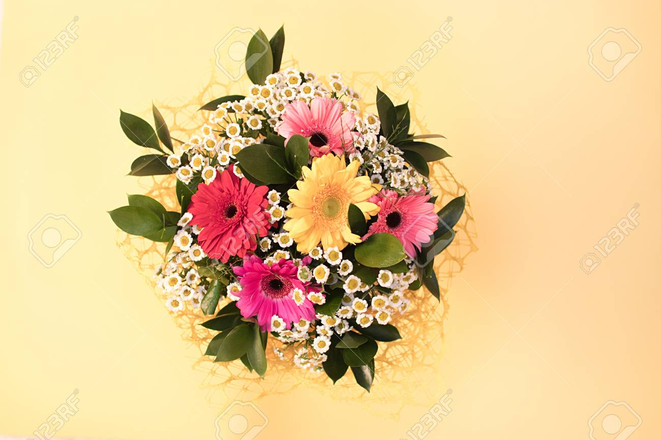 A Bouquet Of Flowers From Small Daisies And Multi Colored Gerbera