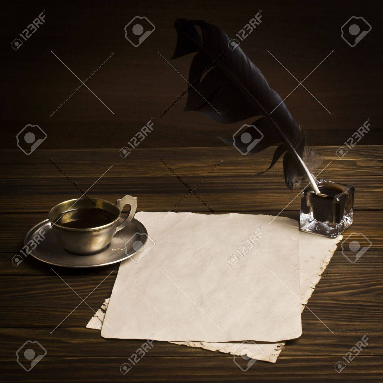 Blank paper and cup of coffee, quill ink - 16247324