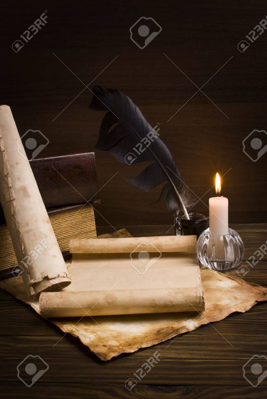 old papers and books on a wooden table - 16228494