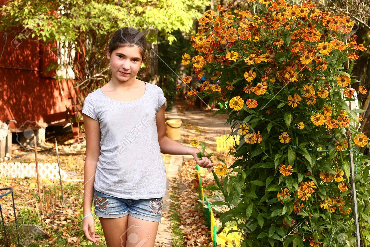 Teen Beautiful Girl Stank On The Blossoming Garden Background Stock ...