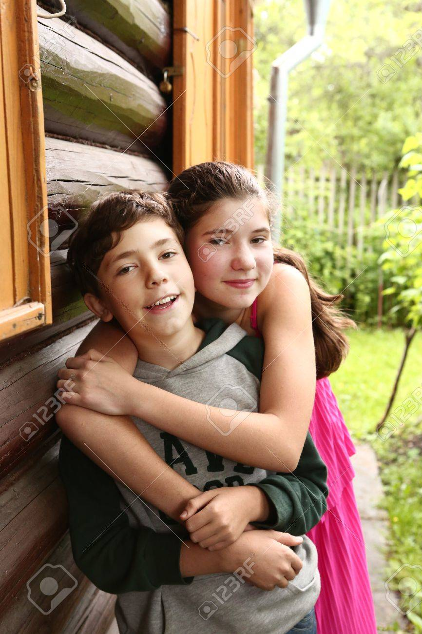 siblings couple brother and sister close up hugging portrait stock