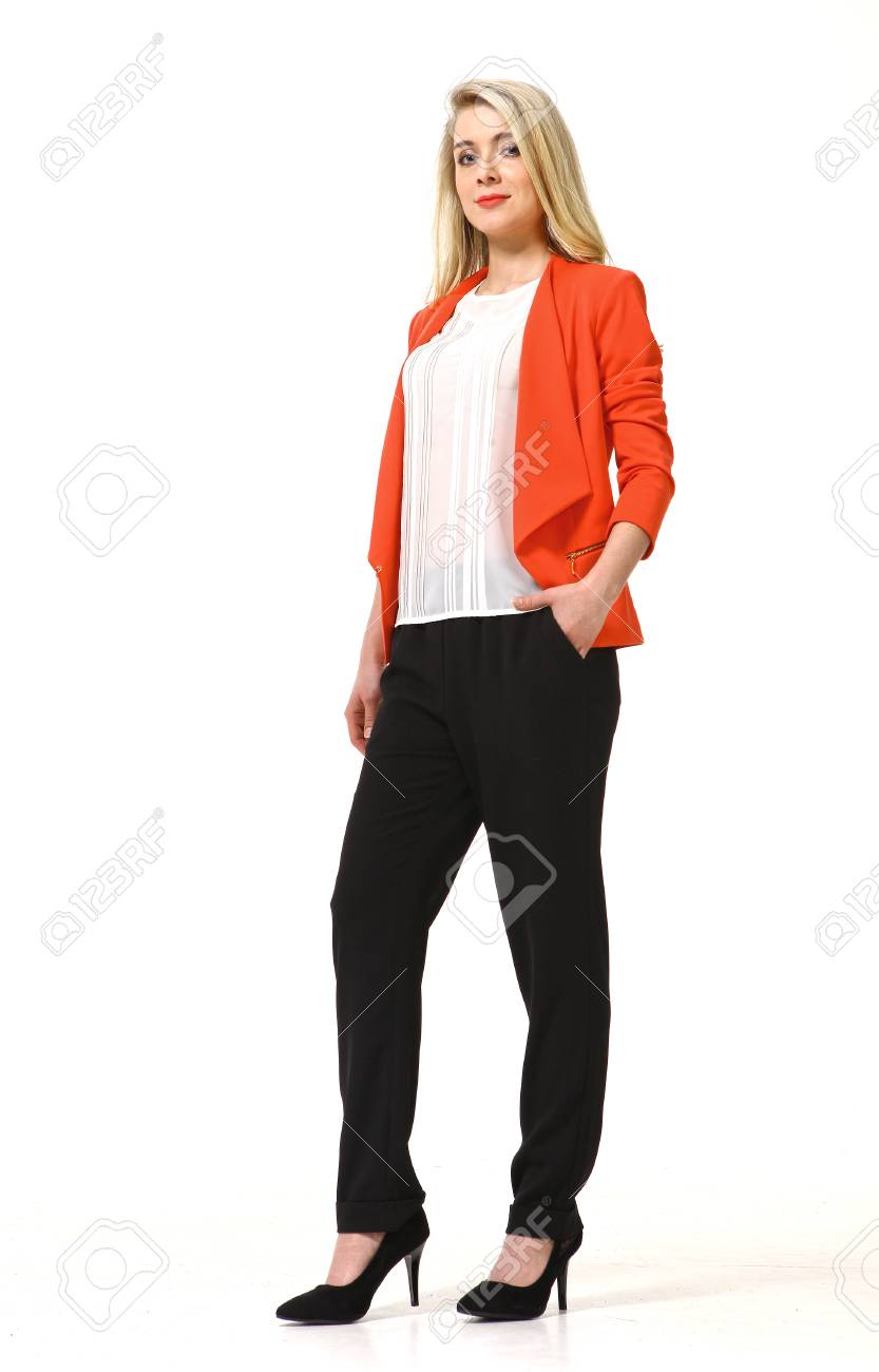 adb650a4c09 Stock Photo - woman with straight hair style in orange casual jacket and  black trousers high heels shoes full length body portrait standing isolated  on ...