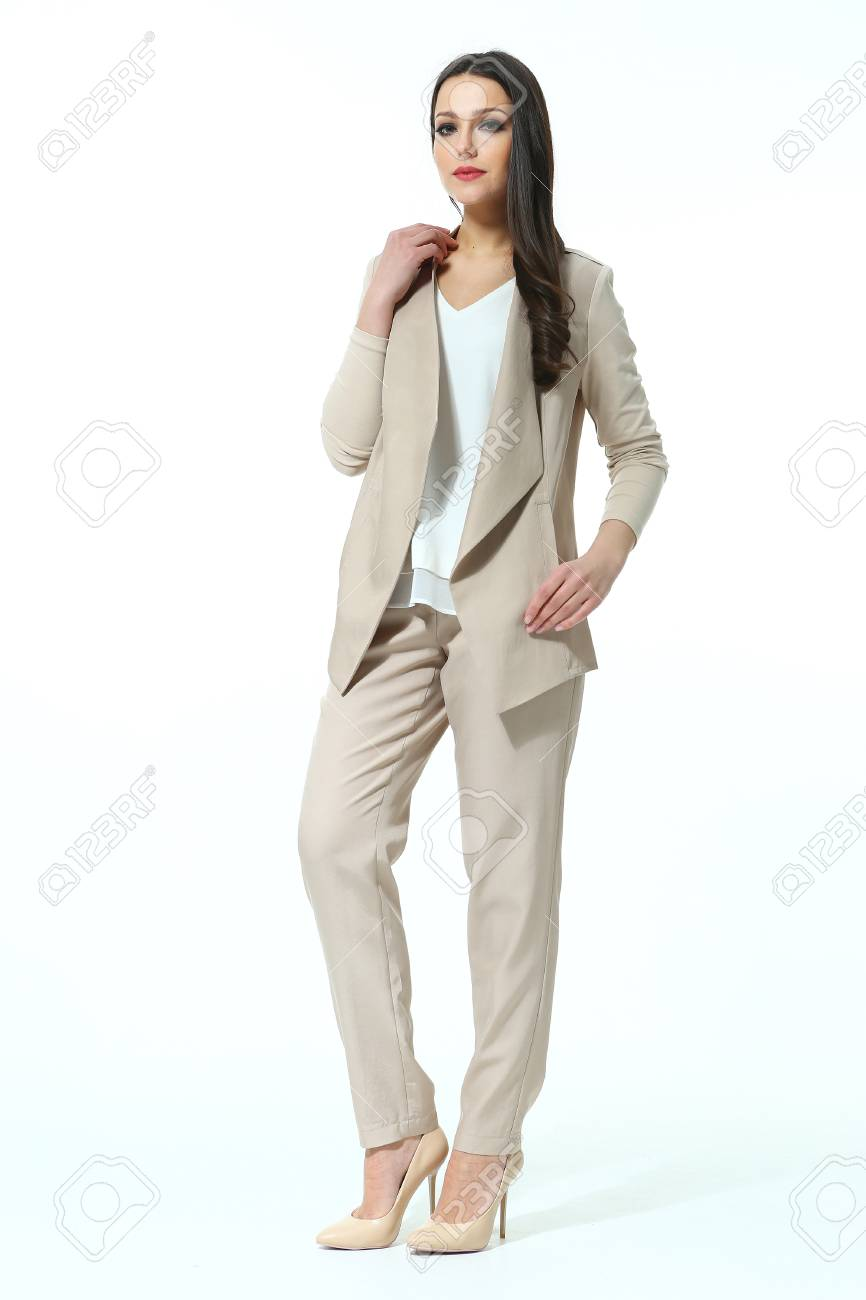 woman with straight hair style in casual office beige paint suit