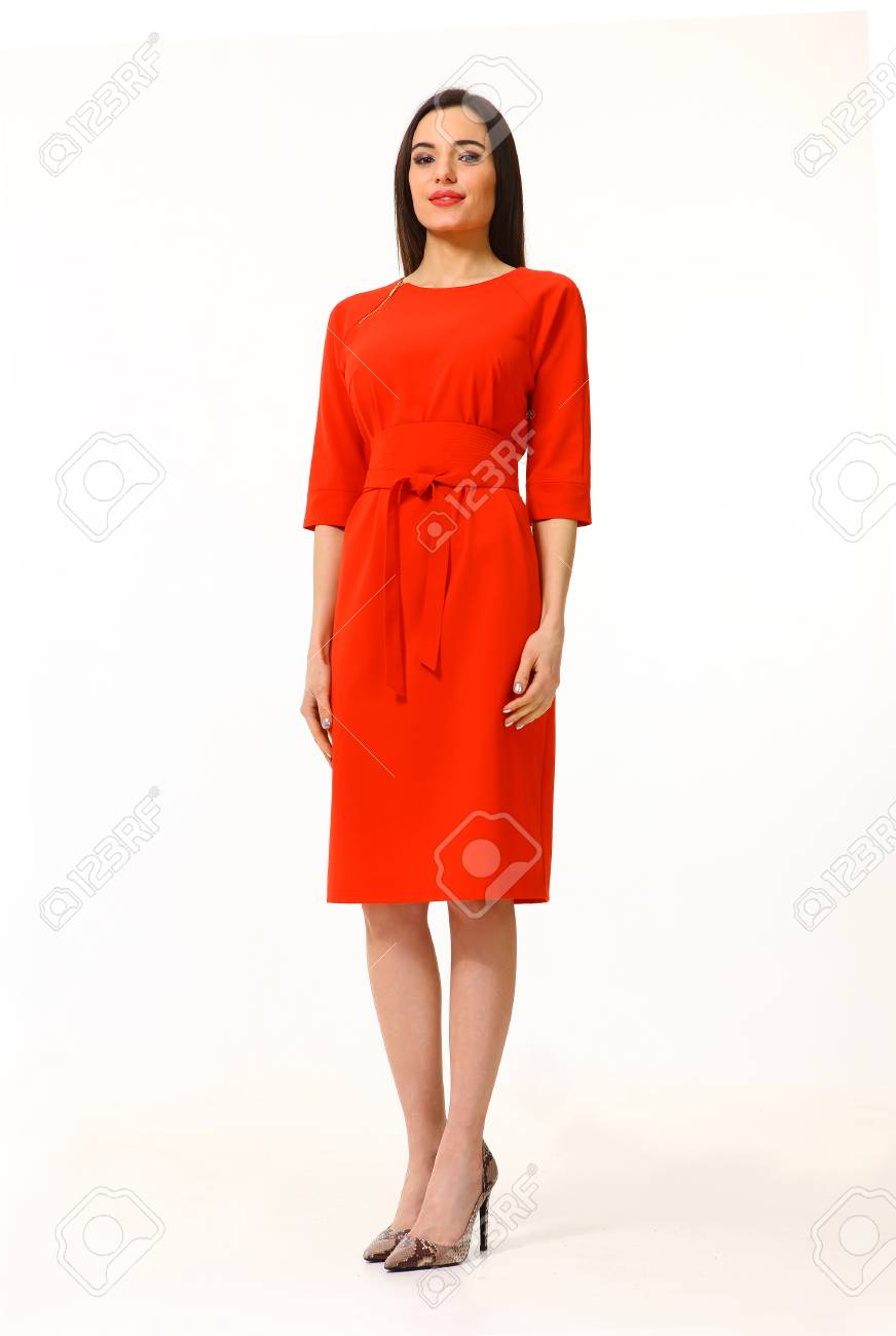 9ec9ba4ba30 woman with straight hair style in party red dress high heels..
