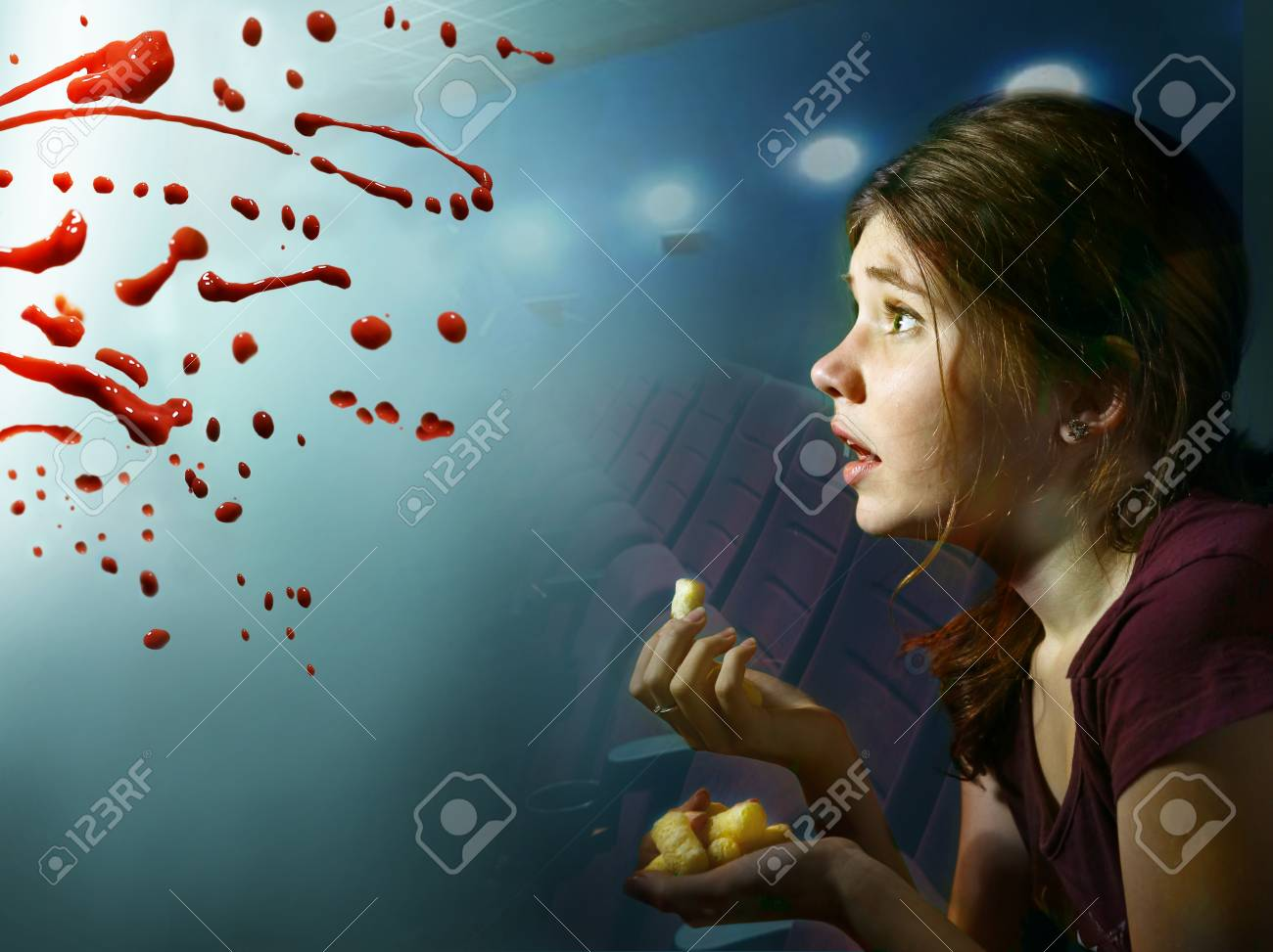 Stock Photo - teen girl watching horror movie with pop corn