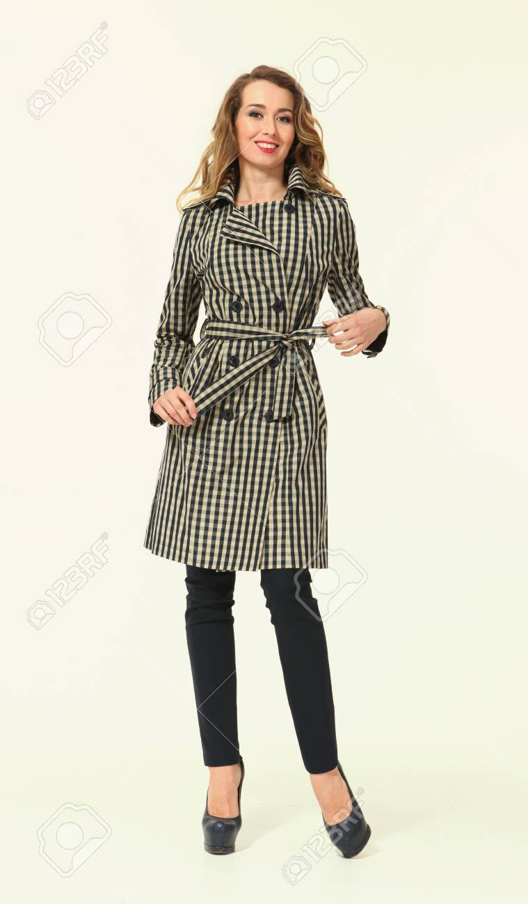 affordable price hot sales pretty nice blond business woman in trench coat high heels shoes full body..