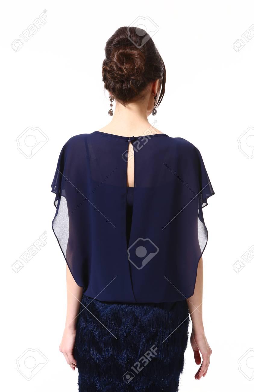 Banque d images - Femme d affaires indienne de mode en chemisier bleu foncé  formidable et style de cheveux updo gros plan photo vue arrière isolé sur  blanc a2d279ac1fd