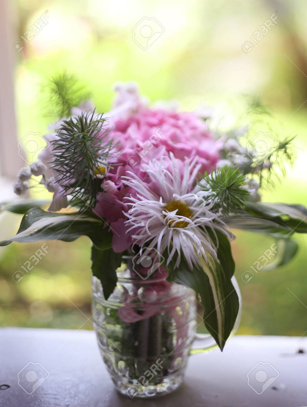 Cute Mini Hydrangea Bouquet In Beer Mug Stay On The Windowsill ...