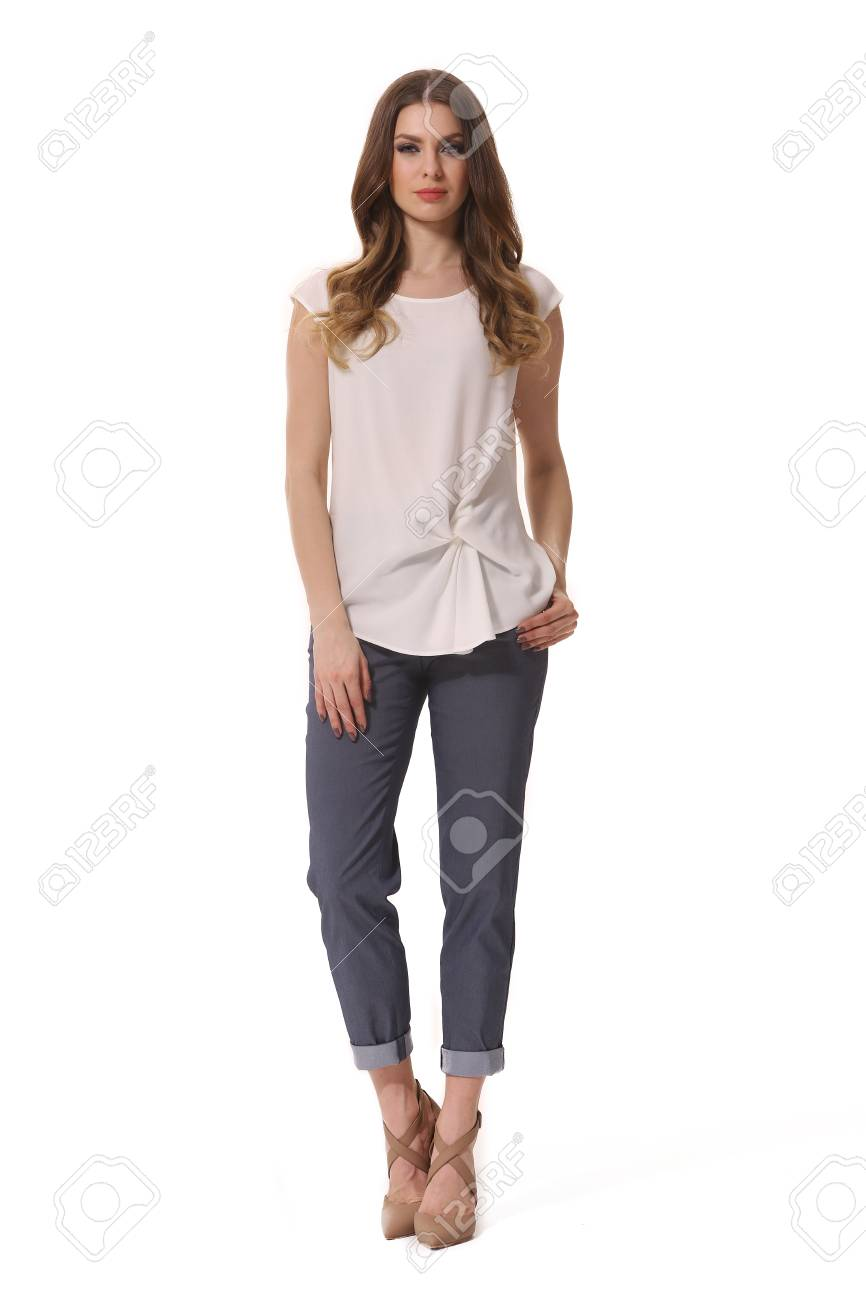 6d094da040c Stock Photo - young caucasian business woman executive posing in summer  casual print blouse and jeans high heels stiletto shoes full body length  isolated on ...